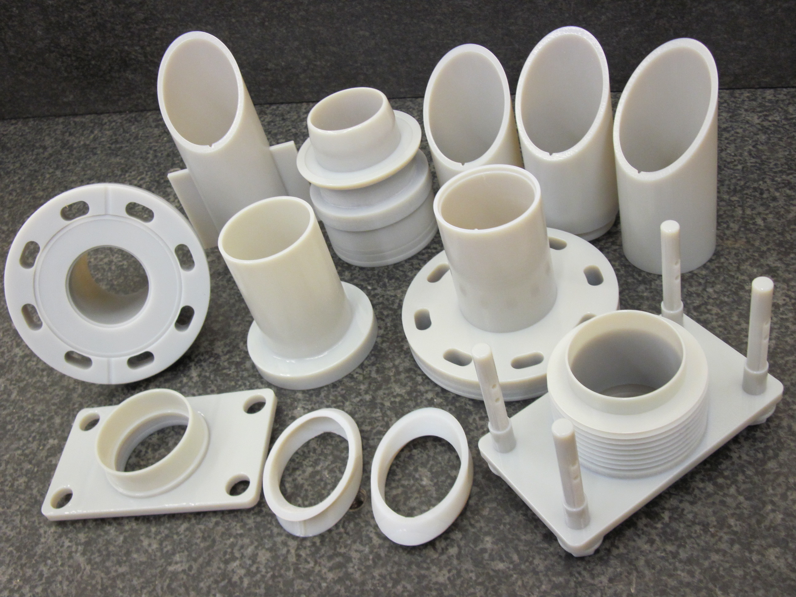 Set of nine flanged tubes and their fittings made in white plastic
