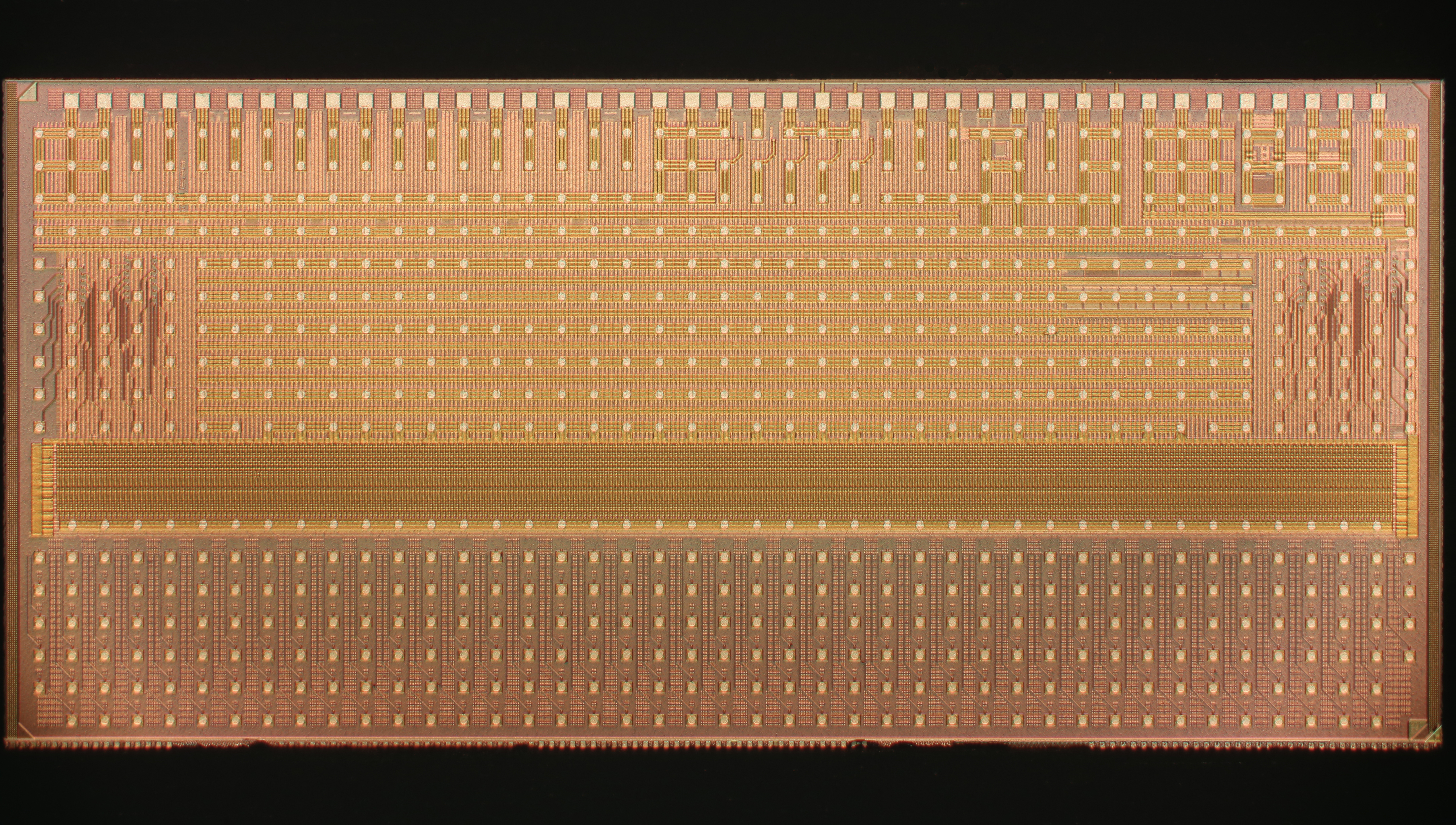 A top view of a single CBC integrated circuit showing the upper layer of metal interconnect tracks and the array of pads used to connect the chip to the module circuit board.